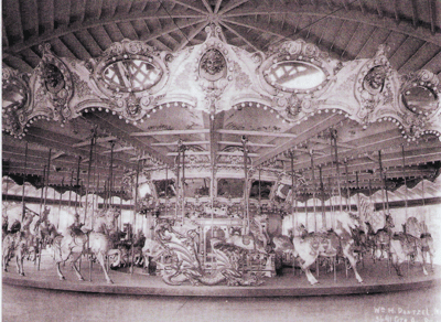 "This factory photograph, signed by Wm. H. Dentzel, (at lower right) shows the grand carousel newly installed in Carsonia Park. On this side, the outer row standing horse known as a ""thoroughbred"" and named ""Tony"" can be recognized to the right of the dragon chariot at center. Photograph from the collection of George M. Meiser, IX and Gloria Jean Meiser."