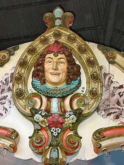 Jester head shields made of molded plaster ornamented the crowning rims of Dentzels carousels. They were used to hide the overhead drive mechanisms and are one means of identifying a genuine Dentzel merry-go-round. Photograph by Chris K. Benson, courtesy of the National Carousel Association.