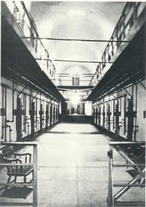 Here is the original 1847-1848 cell block that extended northward from the base of the great (94-foot-high) tower. Within this corridor were 44 cells, eleven on each side and on each story. The five steps seen in the rear led to the 1889 annex, which was built to contain another 50 cells.