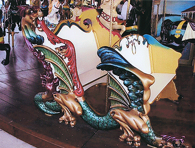 Although the painting technique, metallic paints and the palette are not the factory originals, artist Michael Angelino has selected the colors and used her creativity to accentuate the details of the remarkable carvings on the Illions chariots. Photograph courtesy of Kary Barnett, Carousel Restoration Coordinator.
