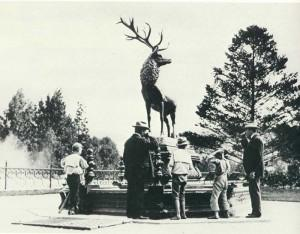 "The often-photographed Elk Fountain was designed and made by J.W. Fiske of New York City. The eight drinking posts surrounding the elongated octagonal basin were each 4-feet 2-inches high. The basin itself measured nearly 12 by 15 feet. Supporting the elk was a base of iron, painted black. At each end was a lion's head which carried overflow from the filtering arrangement. The elk, described as standing in a defiant attitude, was painted in ""the natural colors of the animal""."