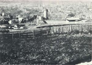 This rare view of the Penn's Common fairground, taken in the mid-1870's, looks northwestward from about the present-day intersection of Hill Road and Clymer Street. Notice to what extent the racetrack stands above the fairground buildings to the left. Notice, too, the 159-foot-long grandstand along the western length of the track.