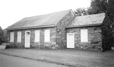 The quaint 1777 fieldstone Pricetown Brethren meetinghouse is located approximately one block southeast from the junction of Routes 12 and 662. The addition to the right houses the walk-in fireplace used for making congregational meals.
